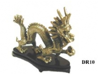 Brass Dragon on wooden plinth.