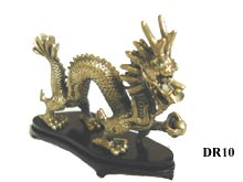 Brass Dragon on wooden plinth.